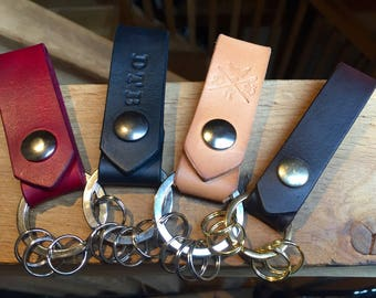 Leather belt loop keychain fobs in various colours, with nickel or brass split-rings to attach your keys