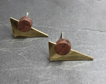 Geometric stud earring made from reclaimed mahogany, brass and silver. A contemporary wooden circle, polished brass triangle and silver back