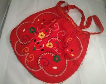 Altered Embroidered Apron from Portugal into cross-body purse with black satin Fabric