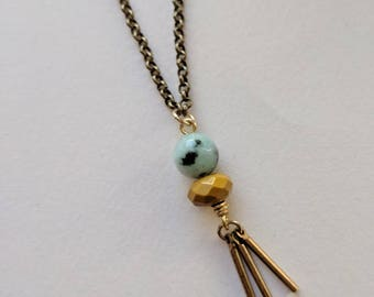 Double stone necklace with brass sticks in mustard yellow and dalmatian jasper
