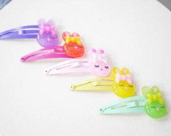 2x glittery bunny hair clips