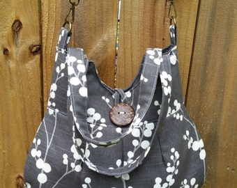 Fleurie bucket shaped crossbody Bag with 2 pockets