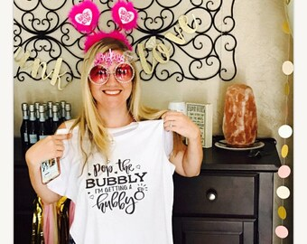 Pop the bubbly I'm getting a hubby t-shirt available in size s, med, large, and Xl for women funny womens graphic tee