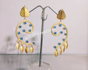 Stylish earings on metal studded with color stone. gold plated
