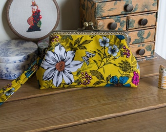 Wristlet purse or small clutch made with modern botonical cotton prints that evoke the change of seasons from summer to autumn