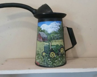 Old John Deere Painted on Old Oil Can in a Pastorial Scene with Red Barn for Tractor Collector.