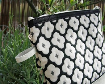 Fabric and beige leather clutch