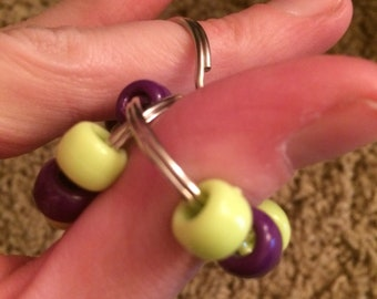 Purple and lime bead-and-ring fidget