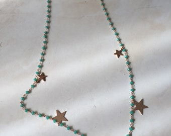 Rosary with pink gold starlet.