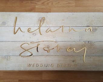 bespoke sign on wooden background