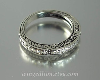 CARYATID wedding band in 14k gold with white sapphires half-eternity band