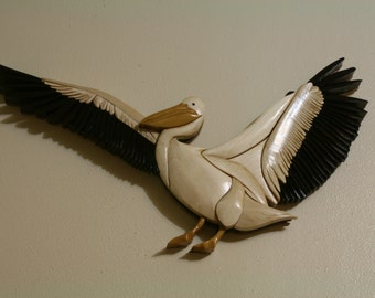 Flying white pelican intarsia