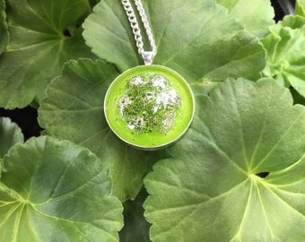 Lime green domed resin pendant with silver beads