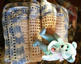Crochet cotton baby blanket afghan is handmade. Variegated shades of blue in border the center is egg shell color. Stroller and travel size.