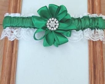 Brooch and green garter