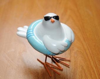 Figurine bird 'bikini and buoy'