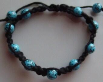 Macrame adjustable unisex bracelet with Robin Egg Blue glass beads and black hemp cording, easy to adjust