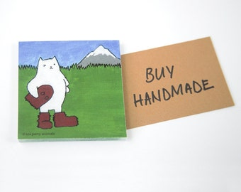 """STICKY NOTEPAD: """"Oregon Cat"""", featuring a winking cat in a Sasquatch or Bigfoot Costume in front of Mt. Hood"""