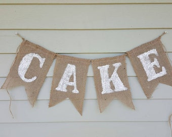 "Burlap ""cake"" banner made by a work from home veteran"