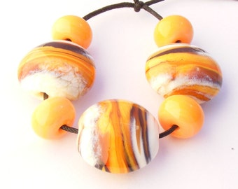 Ivory Orange Amber Black Lampwork Focal Beads with matching spacers