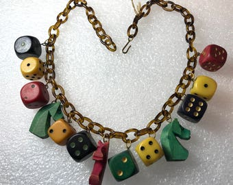 Vintage early plastic and bakelite dice & horses necklace