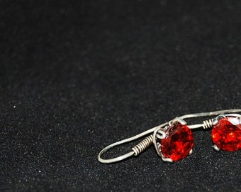Vibrant red CZ wrapped with sterling silver