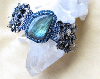 Bracelet, labradorite cabochon  bead embroidered with freeform peyote beading with seed beads, crystals, pewter toggle clasp