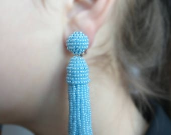 Beautiful Handmade Beaded Pearlescent Baby Blue Tassel Clip on Earrings in the style of Oscar de la Renta. Custom colors available