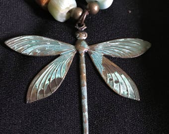 Brass Dragonfly  focal point with hand made Amazonite beads(Colorado), and fossil coral(Indonesia)