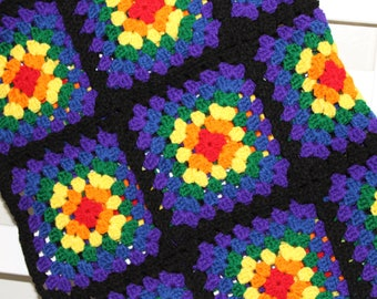 Black rainbow hand crocheted granny square baby blanket red orange yellow green blue purple