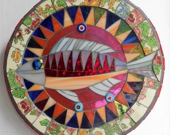 Mosaic fish on a floral dish