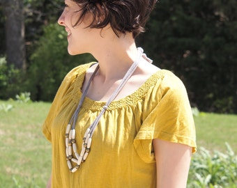 ivory wood rice bib necklace