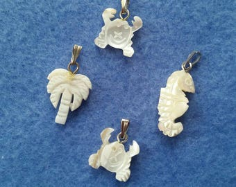 Four Carved Mother of Pearl Ocean Beach Pendants, seahorse, two crabs, palm tree - natural shell with silver tone bails