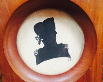 Antique painted silhouette signed