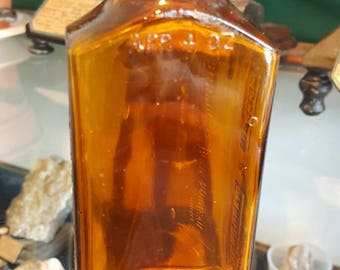Casgraim and Charbonneau vintage pharmaceutical amber bottle