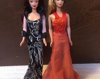Silver & Fire Barbie Dolls, used