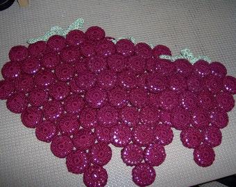 Crocheted grape bottlecap hot pads