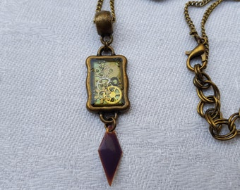 Steampunk pendant resin inclusion, watch gears and sequin purple enamel