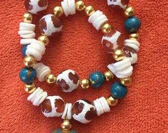 Beaded gold teal and white shell bracelt set