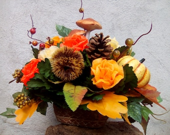 Autumnal still life with earthen pot-rose scented wax and fruit