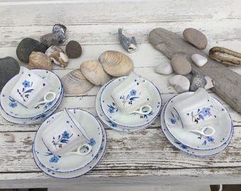 Four trios of vintage Cartwright and Edwards hand painted bone china cups saucers and side plates