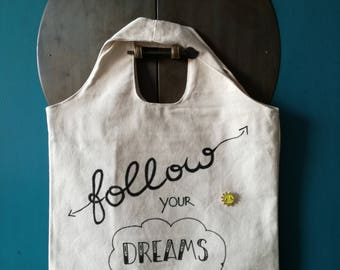 Handmade, durable cotton carrying case with text Follow your dreams and a pin