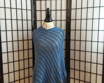 Knitted Blue Poncho with fringe.