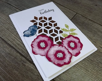Birthday card with cerise flowers and geometric die cut pattern detail