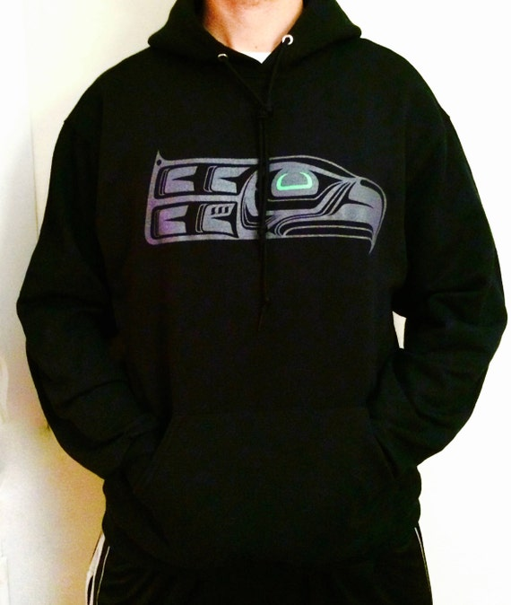 NW Coast Haida Green Eye Totem Seahawk on hoodies and tees