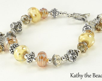 Lampwork Bracelet - Golden Ivory Lampwork Bali and Karen Hill TribenSterling Silver Bead Bracelet - KTBL