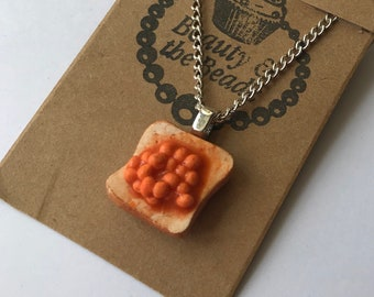 Fun polymer clay miniature beans on toast necklace