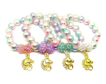 Gold pastel unicorn bracelets party favors in organza bags - Girls unicorn birthday jewelry