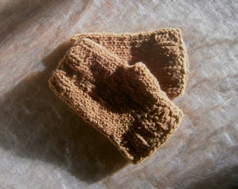 Women hand knitted wool mittens