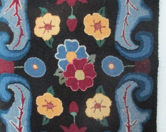 Beautiful vibrant colors hand hooked rug